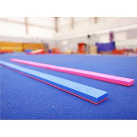 An image of the pink and blue Manique Floorbeam being used in the gym