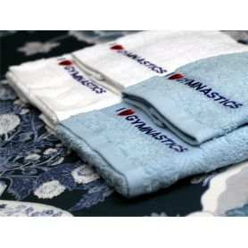 An image of both the white and blue I love gymnastics towels