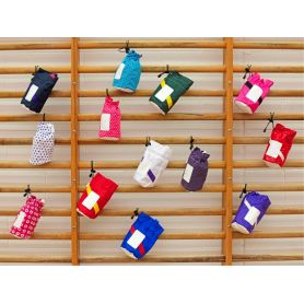 An image of a collection of Manique Handguard Pouches hanging in a gym