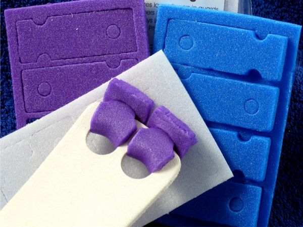 An image of three packs of different coloured Wedgies