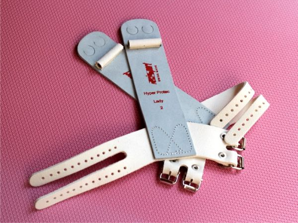 An image of a pair of Reisport Protect Leather A Bar Guards with buckle straps