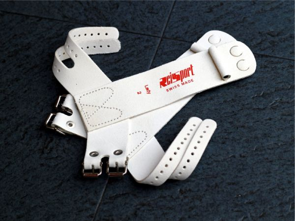 An image of a pair of Reisport Standard Leather A Bar Guards with buckle straps