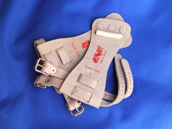 An image of a pair of Reisport Standard Leather High Bar Guards with buckle straps
