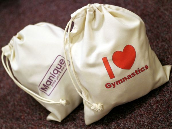 An image of both the Manique Cotton Pouch and I Love Gymnastics Cotton Pouch