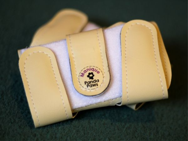 An image of a pair of Faux Leather Panda Paws
