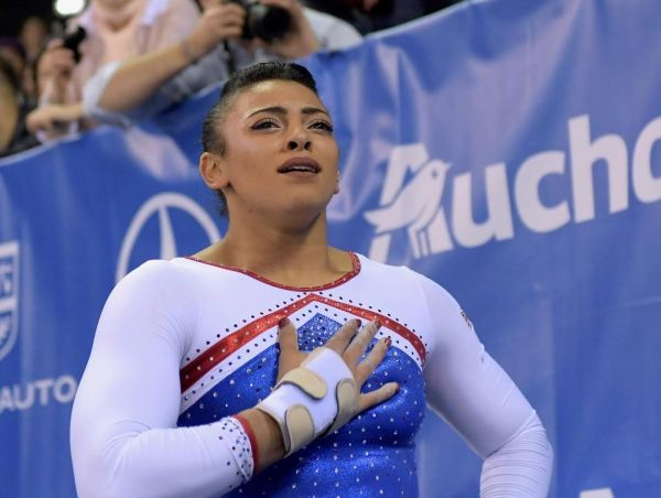 An image of Ellie Downie wearing the Manique Panda Paws